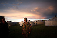 A member of the Mongolian Armed Forces settles in for the night at the camp for operation Pacific Angel Mongolia, a set of ger-- traditional wool-lined tents-- about five hours outside of the capitol of Ulaanbaatar, Mongolia.