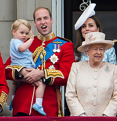 © London News Pictures. 13/06/2015. London, UK. L to R Prince George of Cambridge being held up by his father Prince William, Catherine Duchess of Cambridge, Queen Elizabeth II.  Members of the Royal Family on the balcony of Buckingham Palace during the annual Trooping the Colour Ceremony in central London. The event marks the queens official birthday. .Photo credit: Ben Cawthra/LNP