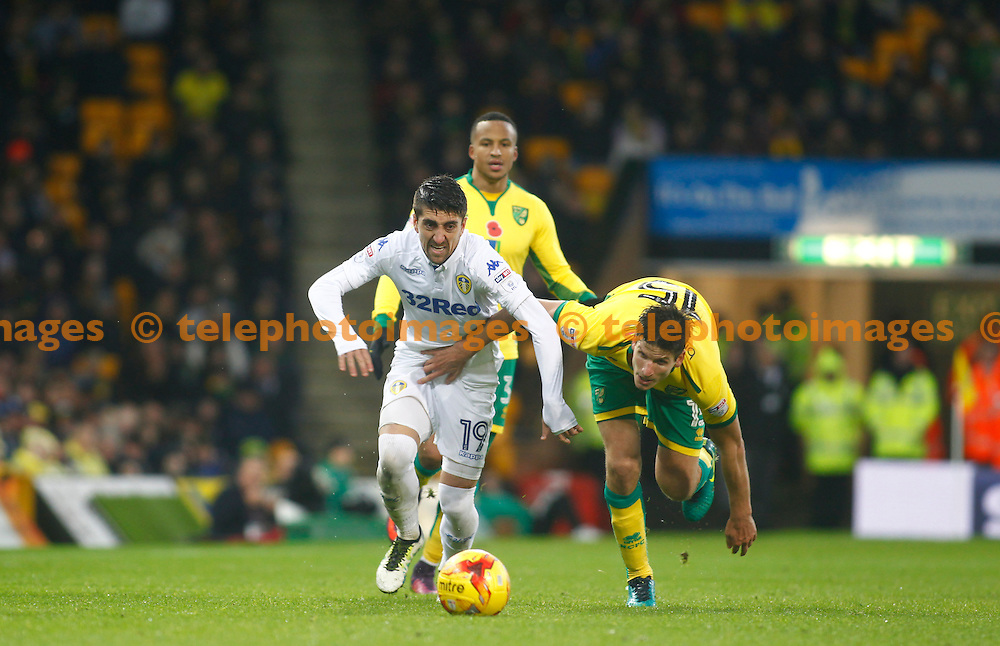 Leeds United's Pablo Hernandez and Norwich City's Timm Klose during the Sky Bet Championship match between Norwich City and Leeds United at Carrow Road in Norwich. December 5, 2016.<br /> John Marsh / Telephoto Images<br /> +44 7967 642437