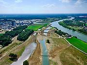 Nederland, Limburg, Gemeente Venray; 27-05-2020; Wanssum, zicht op de Maas en (toekomstige) hoogwatergeul. Op deze lokatie niet alleen de geulen maar ook de toekomstige de uitlaat, links ingang van de Industriehaven. Onderdeel van Gebiedsontwikkeling Ooijen en Wanssum, waaronder aanleg van een  hoogwatergeul, weerdverlaging en natuurontwikkeling.<br /> Wanssum, view of the Maas and (future) high water channel. At this location not only the channels but also the future outlet, on the right the construction of the Hoge Gronddijk. <br /> luchtfoto (toeslag op standard tarieven);<br /> aerial photo (additional fee required)<br /> copyright © 2020 foto/photo Siebe Swart