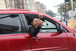 October 5, 2018 - Chicago, Illinois, U.S. - People rally at 71st Street and Jeffery Boulevard in Chicago after a jury delivered a guilty verdict on Friday, in the trial of Chicago police officer Jason Van Dyke in the shooting death of Laquan McDonald. Van Dyke was convicted of second-degree murder in the shooting. (Credit Image: © Zbigniew Bzdak/Chicago Tribune/TNS via ZUMA Wire)