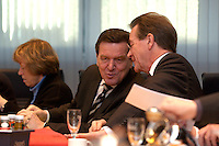 09 JAN 2005, BERLIN/GERMANY:<br /> Gerhard Schroeder (L), SPD, Bundeskanzler, und Franz Muentefering (R), SPD Parteivorsitzender, im Gespraech, vor Beginn der Sitzung des SPD Praesidiums zum Auftakt der Klausurtagungen, Willy-Brandt-Haus<br /> IMAGE: 20050109-01-017<br /> KEYWORDS: Präsidium, Gerhard Schröder, Franz Müntefering, Gespräch