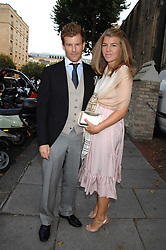 Chef TOM AIKENS and his wife AMBER at the wedding of Chloe Delevingne to Louis Buckworth at St.Paul's Knightsbridge, London on 7th September 2007.<br /><br />NON EXCLUSIVE - WORLD RIGHTS