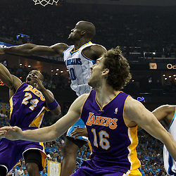 April 28, 2011; New Orleans, LA, USA; Los Angeles Lakers shooting guard Kobe Bryant (24) shoots over New Orleans Hornets center Emeka Okafor (50) during the second quarter in game six of the first round of the 2011 NBA playoffs at the New Orleans Arena.    Mandatory Credit: Derick E. Hingle