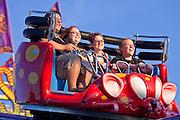 "Oct. 21, 2009 -- PHOENIX, AZ: People ride the ""Crazy Coaster"" on the midway at the Arizona State Fair in Phoenix, AZ. The fair runs through November 8.   Photo by Jack Kurtz"