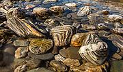 Gneiss stones streaked with quartz,  (set up) Makarora River, Otago, New Zealand.