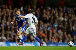 Chelsea Defender Branislav Ivanovic (SRB) is challenged by Basel Defender Marcelo Diaz (CHI) during the second half of the match - Photo mandatory by-line: Rogan Thomson/JMP - Tel: 07966 386802 - 18/09/2013 - SPORT - FOOTBALL - Stamford Bridge, London - Chelsea v FC Basel - UEFA Champions League Group E