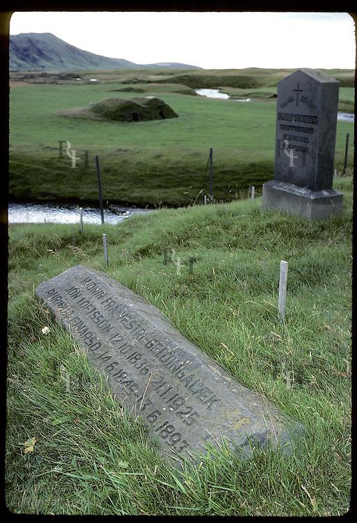 Gravestones in Keldur's small cemetery overlook sod storage huts, still common in Iceland. Iceland