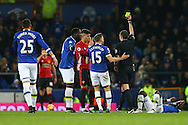 Marcos Rojo of Manchester United receives a yellow card from referee Michael Oliver. Premier league match, Everton v Manchester United at Goodison Park in Liverpool, Merseyside on Sunday 4th December 2016.<br /> pic by Chris Stading, Andrew Orchard sports photography.