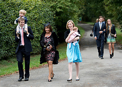 © London News Pictures. 14/09/2013.  Guests  arriving for the wedding of Euan Blair, Son of former British Prime Minister Tony Blair,  to Suzanne Ashman at All Saints Parish Church in Wotton Underwood, Buckinghamshire. The wedding was attended by Former British Prime minister Tony Blair and his wife Cherie Blair. Photo credit: Ben Cawthra/LNP