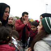 Omar Sidou and his mother Deniz, celebrate the arrival of his siblings at Mytilene port in Lesbos. Omar and his mother got separated from the rest of their family during a rescue operation in Turkish water two weeks before.