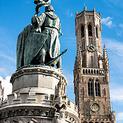 At left is a statue of Jan Breydel and Pieter de Coninck in the Markt (Market Square) in the historic center of Bruges, a UNESCO World Heritage site. The two men, a weaver and a butcher, helped lead a Flemish rebellion against the occupying French in the Battle of the Golden Spurs on July 11, 1302. At right, in the background, is the famous Belfry (bell tower).