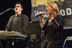 Musical duo featuring a visually impaired performer on keyboards and an able-bodied singer.