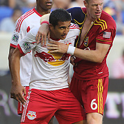 Tim Cahill, New York Red Bulls, is challenged by Nat Borchers, Real Salt Lake, during the New York Red Bulls V Real Salt Lake, Major League Soccer regular season match at Red Bull Arena, Harrison, New Jersey. USA. 27th July 2013. Photo Tim Clayton