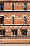 Facade of Keble College oxford. A neo-gothic red-brick building designed by William Butterfield in 1870.