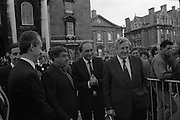 Nissan International Cycle Race..1986..01.10.1986..10.01.1986..1st October 1986..The Nissan Classic began today from Trinity College,Dublin. The offical race starter was The Taoiseach,Dr Garrett FitzGerald TD. He was accompanied by the Minister for Sport,Mr Sean Barrett TD..Sean Kelly was returning to defend his title but his opposition included Greg LeMond, the 1983 world champion and the winner of the Tour de France of the previous July. Roche was out due to his injured leg. Adri van der Poel was back with 1980 Tour de France winner and 1985 world champion Joop Zoetemelk. Teun van Vliet was back too. The winner of the green jersey of the Tour de France that July, Eric Vanderaerden was there as well as Australians Phil Anderson and Alan Peiper as well the Scottish cyclist Robert Millar...Image of the Minister for Sport,Mr Sean Barrett,TD rubbing his hands in anticipation as An Taoiseach,Dr Garret FitzGerald and officials from Nissan move to the starting point of the race.