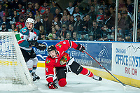 KELOWNA, CANADA - APRIL 8: Gordie Ballhorn #4 of the Kelowna Rockets checks Cody Glass #8 of the Portland Winterhawks to the ice behind the net in second period on April 8, 2017 at Prospera Place in Kelowna, British Columbia, Canada.  (Photo by Marissa Baecker/Shoot the Breeze)  *** Local Caption ***