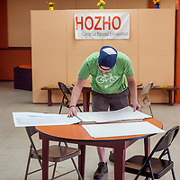060513       Cable Hoover<br /> <br /> Event organizer Russ Ouellett preps the art supplies during the first weekly Art Party at Hozho Center in Gallup Wednesday.