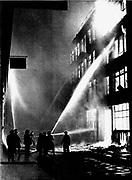 World War II 1939-1945. Firemen fighting a blazing City warehouse after a German air raid during the London Blitz, 1940.