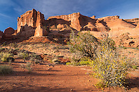 Early morning sunlight shines on the Courthouse Towers in Arches National Park.<br />