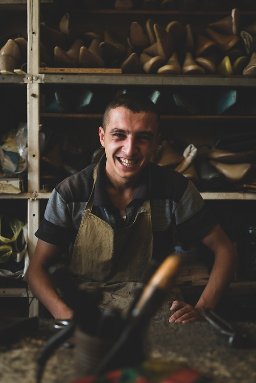 Valeri Danielyan sits in his workpalce,  a small shoe shop in Stepanakert, the capital of Nagorno-Karabakh.<br /><br />(September 22, 2016)