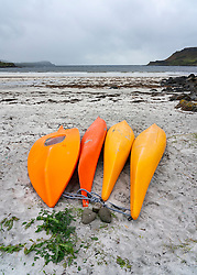 Orange kayaks on beach at Calgary on island of Mull, Argyll and Bute, Scotland, UK
