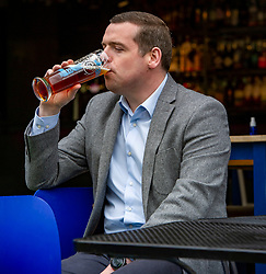 Pictured: <br />Scottish Conservative Leader Douglas Ross was joined by Scott Douglas, Conservative candidate for Edinburgh South, at 56 North in Edinburgh to celebrate the easing of lockdown with <br />pubs reopening. The pintas of Edinburgh Lagerb from th3e Edinburgh Beer Company went down smoothly after lockdown.<br /> <br />Ger Harley | EEm 26 April 2021