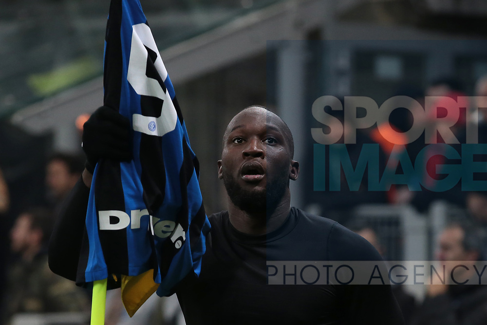 Romelu Lukaku of Inter celebrates by removing his shirt and hanging it on the corner flag after scoring to give the side a 4-2 lead during the Serie A match at Giuseppe Meazza, Milan. Picture date: 9th February 2020. Picture credit should read: Jonathan Moscrop/Sportimage