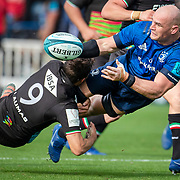 DUBLIN, IRELAND:  October 9:    Rhys Ruddock #8 of Leinster makes a pass while tackled by Nicholas Casilio #9 of Zebre during the Leinster V Zebre, United Rugby Championship match at RDS Arena on October 9th, 2021 in Dublin, Ireland. (Photo by Tim Clayton/Corbis via Getty Images)