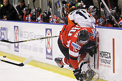 24.04.2010, Eishalle, IJssportcentrum, Tilburg, NED, IIHF Division I WM, Gruppe A, Österreich vs Niederlande im Bild Manuel Latusa (l) checks Lars van Sloun into the boards, EXPA Pictures © 2010, PhotoCredit/ EXPA/ Fintan Planting / SPORTIDA PHOTO AGENCY