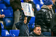 A young fan holds up a request for a shirt during the The FA Cup match between Chelsea and Manchester United at Stamford Bridge, London, England on 18 February 2019.