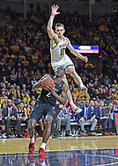 Keith Williams #2 of the Cincinnati Bearcats drives to the basket against Erik Stevenson #10 of the Wichita State Shockers during the second half at Charles Koch Arena in Wichita, Kansas.