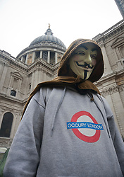 © licensed to London News Pictures. London, UK 18/01/12. An Occupy London protester waits the court decision of the camp's eviction request made by City of London Corporation in St Paul's. Photo credit: Tolga Akmen/LNP