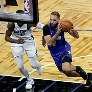 ORLANDO, FL - MARCH 01: Evan Fournier #10 of the Orlando Magic drives to the net past Dorian Finney-Smith #10 of the Dallas Mavericks during the first half at Amway Center on March 1, 2021 in Orlando, Florida. NOTE TO USER: User expressly acknowledges and agrees that, by downloading and or using this photograph, User is consenting to the terms and conditions of the Getty Images License Agreement. (Photo by Alex Menendez/Getty Images)*** Local Caption *** Evan Fournier; Dorian Finney-Smith
