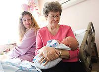 """Jon M. Fletcher/The Times-Union-110207-- Nancy Lemmer holds all 9 lbs, 9 oz. of her new granddaughter, Nora Eldridge Posey, for the first time at Sarasota Memorial Hospital as her daughter Jennifer Posey looks on in Sarasota, FL, November 2, 2007.  <br /> """"I'm so glad I got to meet you,"""" Nancy said to the newborn. (The Florida Times-Union, Jon M. Fletcher)"""