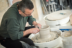 25 February 2020, Jerusalem: Mohammad Tbakhi works on a pot, as he leads ceramics class at the vocational training centre in Beit Hanina. The Lutheran World Federation's vocational training centre in Beit Hanina offers vocational training for Palestinian youth across a range of different professions, providing them with the tools needed to improve their chances of finding work.