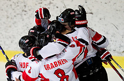 Players of Austria celebrate  during the ice hockey match between National teams of Lithuania (LTU) and Austria (AUT) at 2011 IIHF World U20 Championship Division I - Group B, on December 12, 2010 in Ice skating Arena, Bled, Slovenia.  (Photo By Vid Ponikvar / Sportida.com)