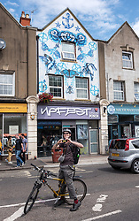 © Licensed to London News Pictures.  28/07/2018; Bristol, UK. Upfest, The Urban Paint Festival, 2018 with themes this year including the Simpsons cartoon series and 100 years of the first women getting the vote. Picture of the Upfest Gallery on North Street. Upfest which is Europe's largest Street Art and Graffiti Festival takes place in the Bedminster area of Bristol between Saturday the 28th and Monday 30th of July. In celebration of their 10th anniversary, Upfest will feature the animated family, The Simpsons with 2018 festival goers treated to artist interpretations including Homer, Marge, Bart, Lisa, and Maggie. The festival has also teamed up with Bristol Women's Voice to celebrate the centenary of the first votes for women, and together Upfest and Bristol Women's Voice will celebrate the progress made since 1918, with three artists including Nomad Clan chosen to portray the suffrage movement and the rights of women. Upfest will have 400 artists from 70 countries in attendance, including this year's lead artists Insane51, L7m, London Police, Nomad Clan, Odeith, and Paris. This year, three Upfest artists have been selected by The Simpsons creator Matt Groening to bring The Simpsons to life in their own unique styles: Bao, born and based in Hong Kong, is known for her freestyle work with vibrant murals and illustrations; Soker, a wildstyle writer, is one of Bristol's finest talents and has been putting his mark on the city since the late 80's; Nomad Clan, the collective of Cbloxx and AYLO, one of the most sought-after duos in the international global street art scene. Upfest will be raising money for The National Association for Children of Alcoholics (NACOA) which offers aid and assistance for children growing up in families affected by alcoholism. Photo credit: Simon Chapman/LNP