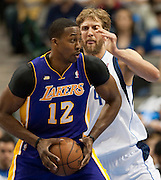 Dirk Nowitzki (41) of the Dallas Mavericks defends against Dwight Howard (12) of the Los Angeles Lakers at the American Airlines Center in Dallas on Sunday, February 24, 2013. (Cooper Neill/The Dallas Morning News)