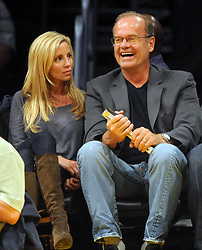 ©2009 GAMEPIKS 310-828-3445<br /> <br /> Kelsey Grammer and his wife Camille sit courtside as they attend the Los Angeles Lakers/Dallas Mavericks NBA game at Staples Center in Los Angeles on October 30, 2009. The Mavericks defeated the Lakers 94-80.<br /> <br /> XYZ (Mega Agency TagID: MEGAR63945_20.jpg) [Photo via Mega Agency]