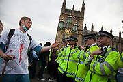 The blocking of Westminster Bridge is over but police is only letting people leave south side not to have any spilling into Parliament Sqaure. This protestor is denied leaving North way  and he is trying to get into a converstion with police on Government policies.<br /> The Health and Care Bill has been passed by Parliament and is due to go to the House of Lords. In protest against the bill which aim to deconstruct and privatise large parts of the NHS UK Uncut activists together with health workers and trade unionists blocked the Westminster Bridge from 1pm til 5.30pm.