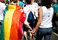 Two women hold hands as they attend the annual Gay Pride parade in London, Britain, 29 June 2013. BOGDAN MARAN / BPA