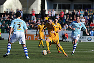 Newport county's Robbie Willmott  (c) in action. Skybet football league two match, Newport county v Exeter city at Rodney Parade in Newport, South Wales on Sunday 16th March 2014.<br /> pic by Andrew Orchard, Andrew Orchard sports photography.