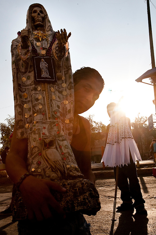 A Sante Muerte devotee crawls on his knees toa popular shrine in Tipito in Mexico City.