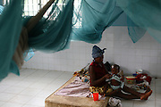 A woman feeds her child at the therapeutic feeding center of the Magbenthe hospital in Makeni, Sierra Leone on Thursday February 26, 2009. UNICEF sponsored some of the construction of the hospital facilities, and also provides high-protein biscuits and milk as part of a joint effort with the World Food Programme..