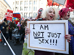 "© licensed to London News Pictures. London, UK 03/03/2012. A woman carries a placard which reads ""I am not just sex"" as women marching at Million Women Rise march against male violence and rape in London, this afternoon (03/03/12). Photo credit: Tolga Akmen/LNP"