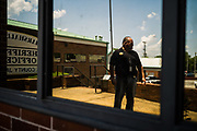GUNTERSVILLE, AL – MAY 24, 2019: Newly elected sheriff Phil Sims stands outside the Marshall County Jail and Sheriff's Office, which suffered years of neglect from the previous administration. Prior to vacating office, defeated incumbent J. Scott Walls emptied the coffers of the Marshall County Sheriff's Office, wiring tens of thousands of public dollars to himself and spending lavishly on unnecessary expenditures such as barrels of dish soap, 20,000 rolls of toilet paper and hundreds of boxes of garbage bags. When the excess supplies were discovered, most had to be sent back to suppliers, costing the new sheriff $2,500 in restocking fees. Sheriff Phil Sims, Wall's successor, now find themselves strapped for funds as they attempt to rehabilitate and repair an overcrowded jail system that has also suffered years of neglect. The incident in Marshall County is just one of many in the state of Alabama, where a trend among outgoing Sheriffs repeatedly leaves their replacements hamstrung for resources – and sometimes even unable to feed the inmates of the county jails they oversee.