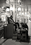 Berlin GERMANY   Shoe Shine.  Europa Centre, Shopping Arcade. Tuesday    20/04/2010  [Mandatory Credit. Peter Spurrier/Intersport Images] Street Photos