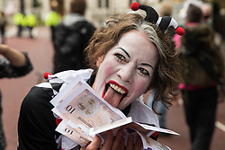 London, UK. 3rd September, 2020. A clown holding bank notes joins fellow climate activists from Extinction Rebellion attending a 'Carnival of Corruption' protest against the government's facilitation and funding of the fossil fuel industry. Extinction Rebellion activists are attending a series of September Rebellion protests around the UK to call on politicians to back the Climate and Ecological Emergency Bill (CEE Bill) which requires, among other measures, a serious plan to deal with the UK's share of emissions and to halt critical rises in global temperatures and for ordinary people to be involved in future environmental planning by means of a Citizens' Assembly.