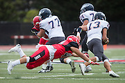 Community College of San Francisco linebacker Chaz Briggs (44) dives for a missed tackle against College of Siskiyous quarterback Gage Ferguson (13) at Community College of San Francisco in San Francisco, Calif., on September 10, 2016. (Stan Olszewski/Special to S.F. Examiner)